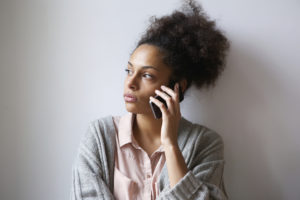 Close up portrait of a young woman talking on mobile phone
